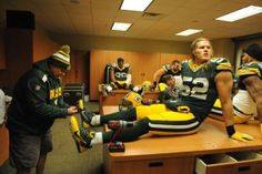 Pre-game November 24, 2013: Clay Matthews #52 getting help with one of is feet, while looking quite endearing sitting on the table.