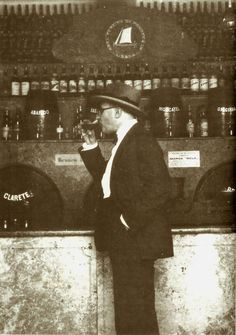 Fernando Pessoa drinking a glass of wine in a tavern in 1929.