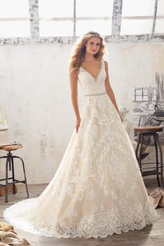 A-line wedding dress idea - lace wedding dress with scalloped hemline + beaded belt. Style 8124 by @morileewedding