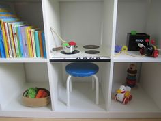 Turn an IKEA bookshelf into a play kitchen.