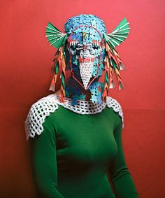 Swiss artist Marie Rime creates masks and armor using recycled objects like board game pieces, party straws, and paper fans.