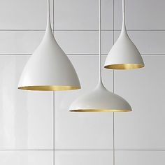 Sleek, minimalist form meets functional lighting in the Agnes Pendant by Visual Comfort. Its body features a rounded, parabolic head (made of metal) which suspends from a near-invisible support stem. Contrasting inner and outer finishes provide additional warmth and depth to the fixture, culminating in a dazzling reflective display once lit.