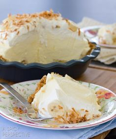 This fluffy banana cream pie recipe is piled high with fresh ripe bananas and creamy vanilla filling, then topped with pillowy whipped cream and toasted coconut.