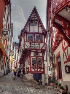 Bernkastel-Kues - The Crooked House. The bottom is a wine cellar and yes, they door drive down both sides of that street!
