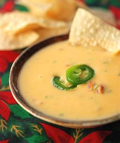 Chile Con Queso. I've got to find a new recipe... Velveeta and Rotel isn't cutting it!