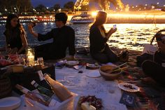 Lost In Cheeseland rustic picnic along the shores of the seine across from the lit-up Eiffel Tower... heaven...