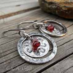 The charms are sterling silver disks that went through he rolling mill, pressed with bits of flower rick-rack. The flowers left a lovely embossed impression on the silver. Earrings Everyday