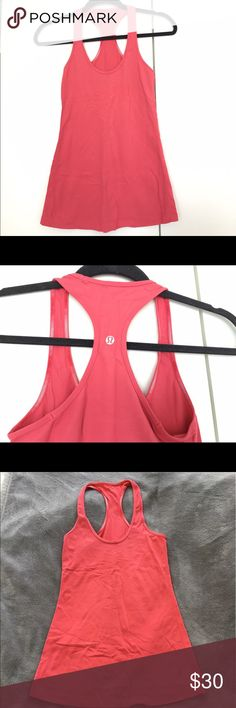 Size 4 Lululemon Cool Racerback Tank Worn twice. Excellent used condition. Color is a beautiful, bright coral. Perfect for summer! lululemon athletica Tops Tank Tops