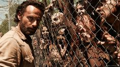 Walking Dead - Rick at the prison fence with walkers breathing down his throat