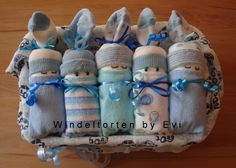 creative homemade baby gift for your next baby shower party: diaper babies in a basket