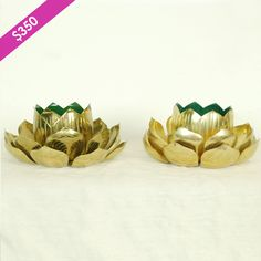 """Pair of brass and enamel Lotus candle holders! 9""""wide x 5""""tall......We offer a wide variety of furniture and accessories. We are located in the Dallas Design District. We can ship to any location in the US. visit us at www.againandagain.com  www.facebook.com/againdesign"""