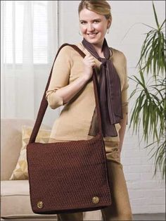 Messenger Bag...The strength of worsted weight nylon cord combined with the sturdy pattern of post stitches gives exceptional durability to this extra-roomy bag...and it's really cute!