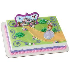 """A royal cake for a little princess. Sophia the First kindly welcomes the birthday girl to her kingdom. The backdrop features the castle, surrounded by Whatnaught, Robin, Mia and Clover. 2-Piece set. Sophia figurine 2""""L x 1 3/4""""W x 3""""H; backgrop 5½""""L"""