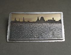 JD226 Sunset over city brooch - sterling silver, 18ct gold. $1275