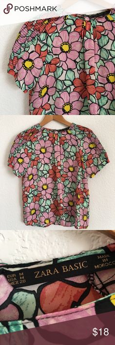 Zara Basic Floral Blouse Zara Basic Floral Blouse, size M, short sleeve with beautiful floral print, rounded neckline, keyhole back, 100% polyester, EUC.                                                                        Measurements:                                                                                  Length from shoulder to hem: 23.5 inches, armpit to armpit: 19.5 inches. Zara Tops Blouses