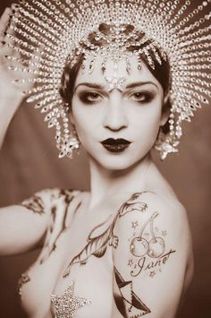 Gorgeous Art Deco face. Love this headpiece, but it certainly evokes a specific time, no?
