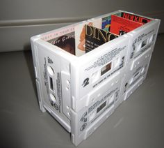 This unique desk organizer is made from 12 cassette tapes. They were originally pop cassette singles from the 80s and 90s. Now, they make a sturdy,