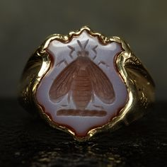 Superb antique signet ring with a shield-shaped sardonyx panel carved with a bee… Antique Rings, Vintage Rings, Antique Jewelry, Vintage Jewelry, Bee Jewelry, Insect Jewelry, Jewlery, Jewelry Box, Sapphire Earrings