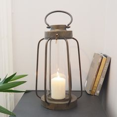 BACK IN STOCK TODAY! With its vintage antique copper look, this trendy metal lantern will take pride anywhere in the home. It's open frame will allow the candlelight to shine through, lighting up any part of the room beautifully. Hurricane Lanterns, Metal Lanterns, Candle Lanterns, Candle Sconces, Vintage Candles, Vintage Lamps, Vintage Antiques, Christmas Accessories, Patio Lighting