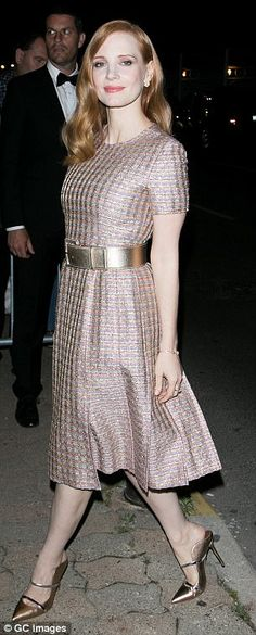 Radiant redhead: Oozing glamour as she headed into the bash, the 40-year-old actress dazzled in a pale pink boucle print midi dress that flattered her porcelain complexion