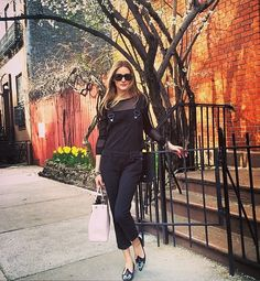 Olivia Palermo in some very stylish black dungarees.