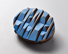 By Julia Turner, Timber Brooch #2 (Blue Peaks), Wood, stain, steel.