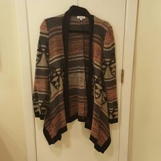 Cute aztec print cardigan! This cozy cardigan has blush, cream, black, and grey in the pattern. Looks cute layered with jeans or a dress! I've only worn it a few times. JustFab Sweaters Cardigans