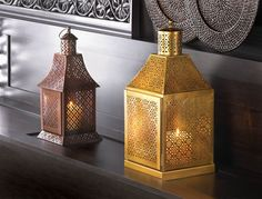 This dramatically large candle #lantern sheds light on the unmistakable truth that it is the epitome of #exotic design. The #floral-inspired cutout pattern adorns its structure from top to bottom, making a fantastic show of light and shadow when a candle is lit inside. Shown with #Labyrinth Candle Lantern.
