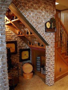 genius. wine cellar under stairs.