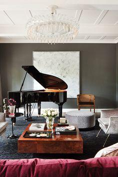 Olive walls, rasberry sofa, moddy blue carpet, walnut coffee table