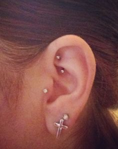 tragus and rook piercings.. this is what my ear would look like if I got the rook! I want.