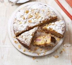 Rhubarb and orange cake - Make the most of seasonal fruit in this rustic bake with almond topping - serve it warm from the oven, as a pudding, or with afternoon tea Bbc Good Food Recipes, Sweet Recipes, Cake Recipes, Unique Recipes, Amazing Recipes, Rhubarb Orange Cake, Delicious Desserts, Yummy Food, Rhubarb Recipes