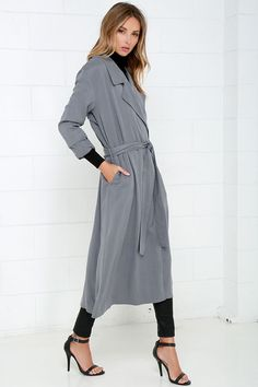 Cruise around town while the stars are out, bundled up in your new Night Drive Grey Trench Coat! Soft, lightweight twill rayon shapes this breezy trench coat with long sleeves, notched collar, open front, and hidden side-seam pockets. Classic trench details like a storm flap at back, and attached sash belt complete this fashionable staple! Kick pleat at back. Unlined. 94% Rayon, 6% Spandex. Hand Wash Cold.