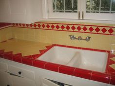 Red and yellow LA deco kitchen countertop Retro tiles in red and yellow/gold on this counter and backsplash. Like the cast iron double sink, 1950s Kitchen, Old Kitchen, Kitchen Tiles, Vintage Kitchen, Kitchen Sink, Diner Kitchen, Kitchen Counters, Kitchen Decor, Vintage Glam