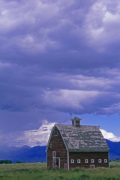 Bridger Mountains and an old barn and pasture in Gallatin Valley near Bozeman, Montana.