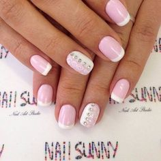 Classic short french manicure with a milk-snow-white smile will pleased many fans. Pale pink paint, complemented with beautiful patterns replace ...