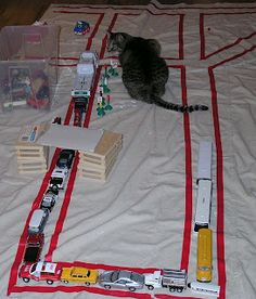 Ways To Play With Toy Cars -- make play scape on drop cloth with colored tape,etc