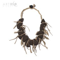 Necklace realized with black sand, suede elements and rope. The fastening is made with a little black wooden ball. Buy it on  ArtEco's Etsy shop! https://www.etsy.com/listing/189042819/necklace-realized-with-black-sand-suede