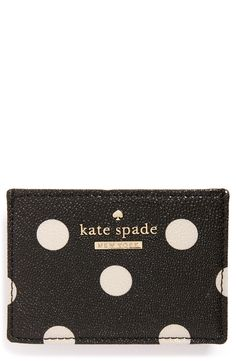 A Kate Spade crosshatched leather card holder in peppy polka dots to keep cash and credit cards organized in style.