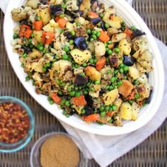Potatoes, carrots, cauliflower and eggplant are oven roasted, then tossed with peas and exotic African spices for a beautiful, bountiful delicious side dish!
