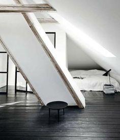 stark minimalist attic bedroom space