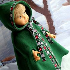 """Deep green fleece cape with arm openings by Cher at SewFunDollClothes. This is perfect with the Christmas through History Kirsten outfit from Karen Dosier, ThreadofTroy. Kirsten loves being """"decked out"""" in this holiday ensemble! ;~)"""