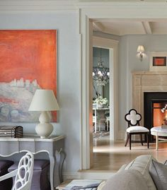Pops of hot orange bring cool blue, violet, and gray to life.  Alexa Hampton, Decorating In Detail
