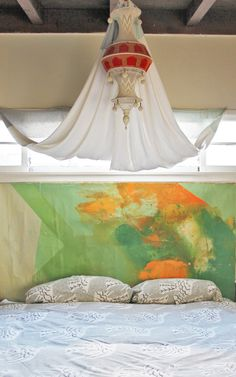 painted canvas as a headboard + canopy