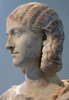 Roman marble bust of a woman in the Metropolitan Museum of Art, inv. 18.145.39.  The hairstyle of this unidentified woman is associated with the middle of the third century (Late Imperial period), a style associated with the wife (Otacilia Severa) of the emperor Philip the Arab (reign: 244-249).
