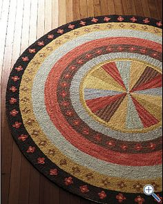 Pinwheel hooked rug>>> love these colors.
