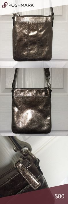 """Coach crossbody swingpack Coach crossbody swingpack in """"gunmetal."""" Only used a handful of times. Shows VERY slight wear on zipper pull (as shown in photo, sort of hard to see), and slight wearing on strap from rubbing against clothing. Excellent condition! Coach Bags Crossbody Bags"""