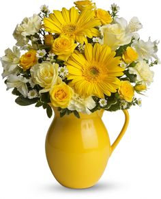 Teleflora's Sunny Day Pitcher of Cheer containing sunny yellow flowers