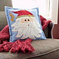 Christmas pillow bearing the jolly guy's likeness