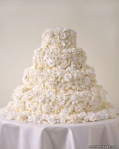"""See the """"Meringue Bouquet Wedding Cake"""" in our Traditional Wedding Cakes gallery Any cake frosted in buttercream can be decorated with crisp meringue flowers in shades of white. On this cake, some flowers are piped in one piece and baked in the oven, while others are piped petal by petal, baked, assembled with more meringue, and baked again; the overall effect is that of a heavily embroidered bodice. The finished flowers, which are easy to cut through, add a delicious crunch to each slice."""